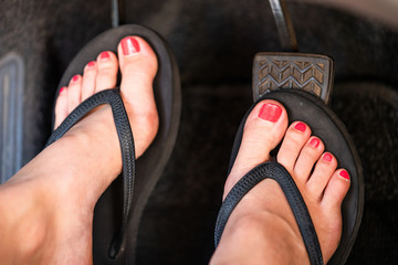 Girl driving in flip flops