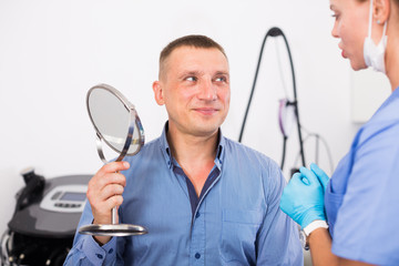 Female doctor is preparing client to procedure