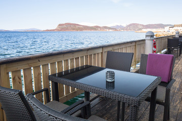 Table at the sea in Alesund town, Norway
