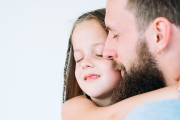 father's care and loving heart. parent and kid bond. portrait of daddy embracing his little child girl. family happiness.