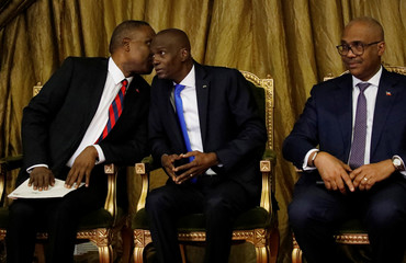 Haiti's nominated Prime Minister Jean Henry Ceant speaks to President Jovenel Moise during the presentation of Ceant's nomination at the National Palace in Port-au-Prince