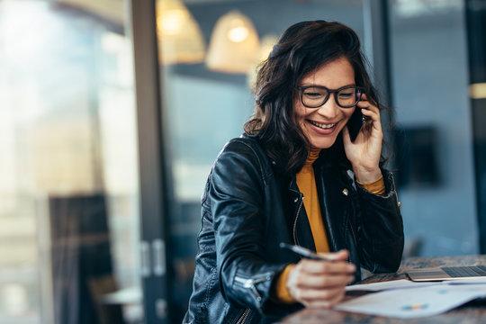 Woman entrepreneur managing her business.
