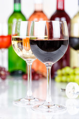 Red wine in a glass portrait format grapes