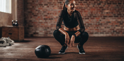 Fitness woman taking break after at gym