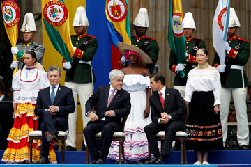 Argentina's President Mauricio Macri, Chile's President Sebastian Pinera and Mexico's President Enrique Pena Nieto (R) participate in the swearing-in ceremony of Colombia's new President Ivan Duque at the Bolivar Square in Bogota
