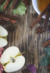 Autumn frame wth tea, apple, cinnamon stick, star anise and clove, copy space, top view