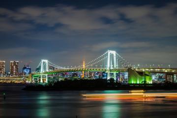 Rainbow bridge at night shot from Odaiba island, Tokyo, Japan.