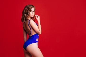 Pretty bikini model in studio