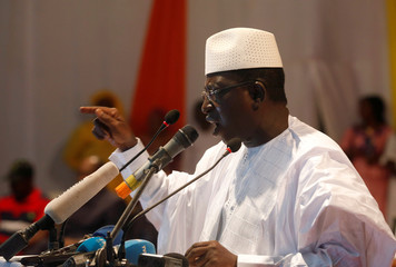 Soumaila Cisse, leader of opposition party URD speaks during protest against what they say were vote count irregularities in Bamako