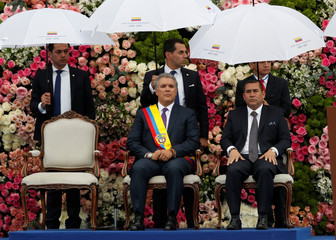 Colombia's new President Ivan Duque looks on alongside President of the Congress Alejandro Chacon Camargo (R) after being sworn in during his inauguration ceremony at the Bolivar Square, in Bogota