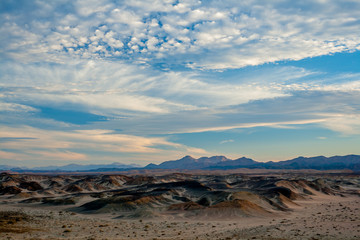 An Early Evening Magical View of the Clouds, the Desert and the Distant Mountains in Egypt