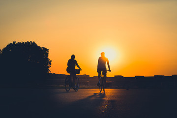 couple /  two people riding bicycle