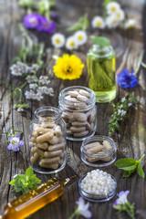 alternative herbal medicine. herbal vitamin on ols wooden board background.