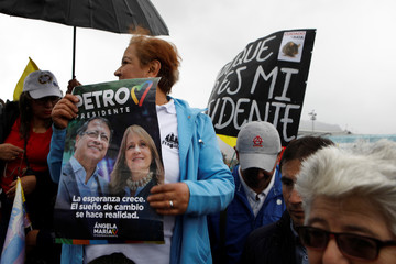 Opposition supporters gather as the swearing-in ceremony of Colombia's new President Ivan Duque takes place, in Bogota