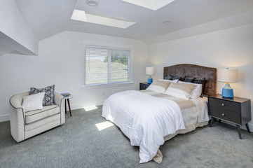 Amazing white bedroom with skylights.