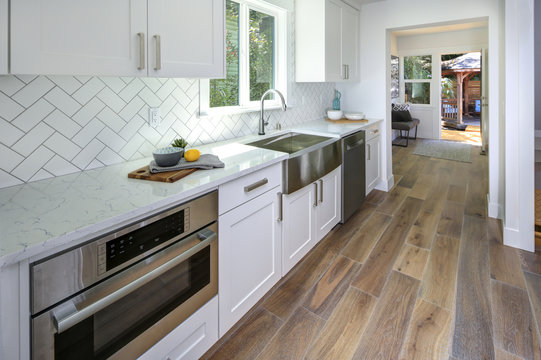 Remodeled kitchen with pure white cabinets.