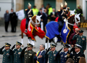 Colombia's new President Ivan Duque and members of the Armed Forces stand during Duque's swearing-in ceremony at Bolivar Square in Bogota