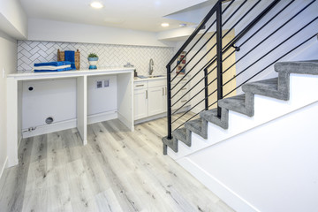 Basement laundry room interior with a sink.