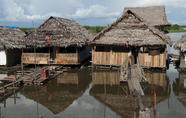Traditional house on the Amazon river in Iquitos, Peru