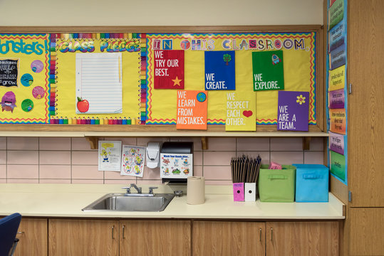 Colorful bulletin boards above the sink in an elementary classroom