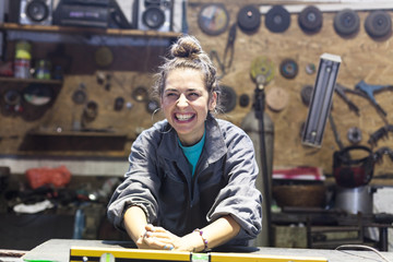 happy young woman working in a workshop