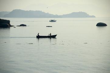 Fishermen paddling silhouette