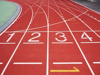Red running track with numbers at the stadium