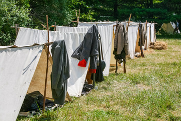 Rows of Civil War tents at a reenactment of a civil war encampment