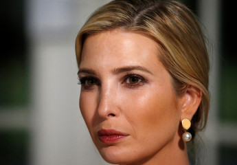 White House Senior Advisor Ivanka Trump listens as her father U.S. President Donald Trump speaks at a dinner with business leaders at Trump National Golf Club in Bedminster