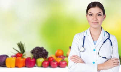 Medical doctor woman over Diet and health