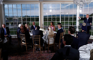 U.S. President Donald Trump speaks at a dinner with business leaders at Trump National Golf Club in Bedminster