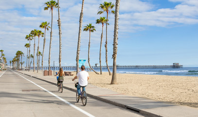 People riding Bikes at beach