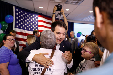 Democratic candidate Danny O'Connor hugs a supporter at his election night party for a special election in Ohio's 12th congressional district in Westerville Ohio