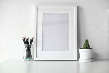 Mockup poster on white desk.