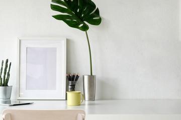 Mockup poster, workspace on white desk.