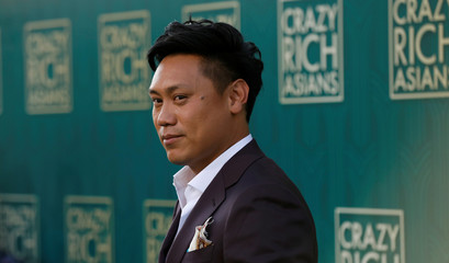 "Director Chu poses at the premiere for ""Crazy Rich Asians"" in Los Angeles"