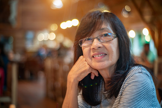 senior woman sitting in restaurant