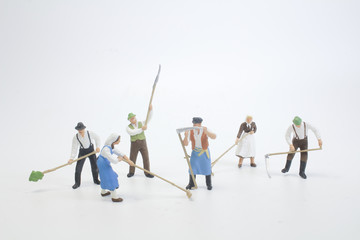 a Close up of Miniature farmer people isolated