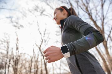 Runner wearing fitness smart watch running