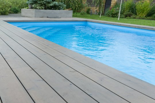 Special wooden board around the swimming pool, texture, background.