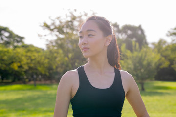 Portrait Of Beautiful Chinese Woman Ready For Exercise In Park