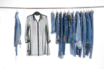 Clothes shirts ,shorts jeans, with mix jeans shirt, jacket isolated on hanging