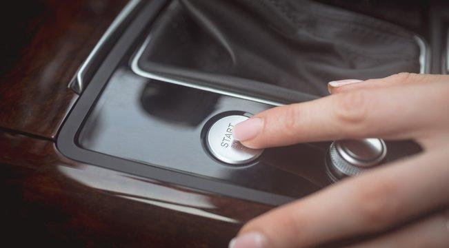 Female executive using starter of car