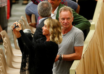 Singer Sting and his wife Trudie Styler arrive to attend the general audience at the Paul VI Hall in Vatican