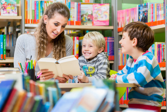 Family reading books in the library for education and entertainment