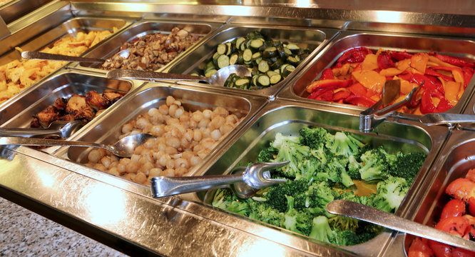 self-service restaurant with many trays filled with broccoli pep