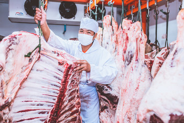 Butchers work in meat curing. Happy of the butcher Thai-French beef
