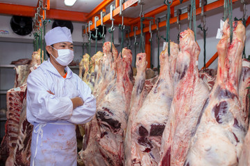Butcher standing beef in meat curing plants. Thai - French Beef Sakon Nakhon Thailand.