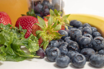 Close Up Blueberries, Strawberries and Kale