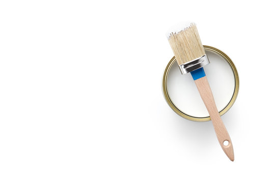 Can of white paint and brush isolated on white background, top view